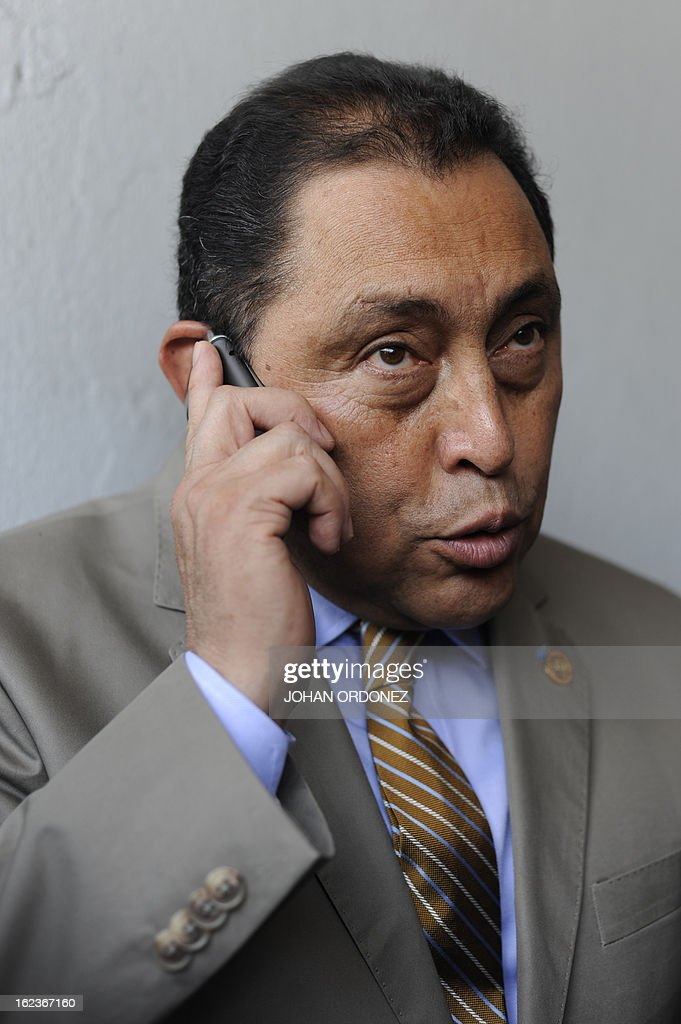 Guatemalan Interior Minister Mauricio Lopez speaks with journalists in Guatemala city on Feburary 22, 2013. Lopez referred to the death of two drug traffickers in a clash with police, one of whom could be related to the Mexican Sinaloa cartel. AFP PHOTO Johan ORDONEZ