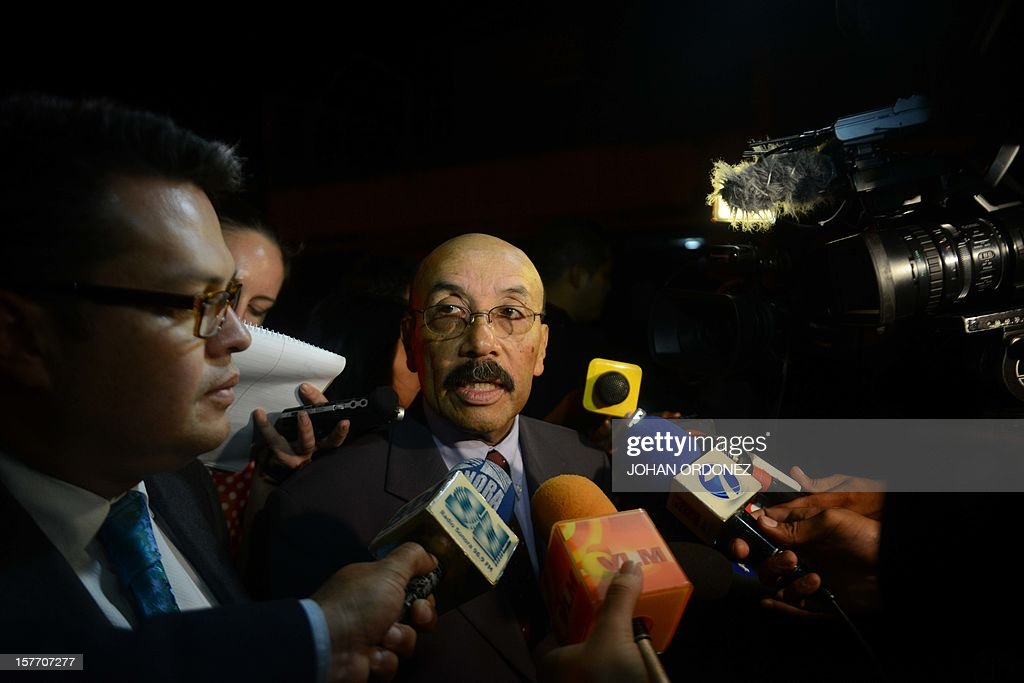 Guatemalan lawyer Telesforo Guerra, who represents US anti-virus software pioneer John McAfee, speaks with journalists outside of the detention center of the immigration departament in Guatemala City on December 05, 2012, after McAfee was arrested in the Guatemalan capital for illegal entry, according to police. McAfee requested political asylum in Guatemala, his lawyer said December 5, 2012, after fleeing Belize where he is wanted for questioning over his neighbor's murder. AFP PHOTO / Johan ORDONEZ