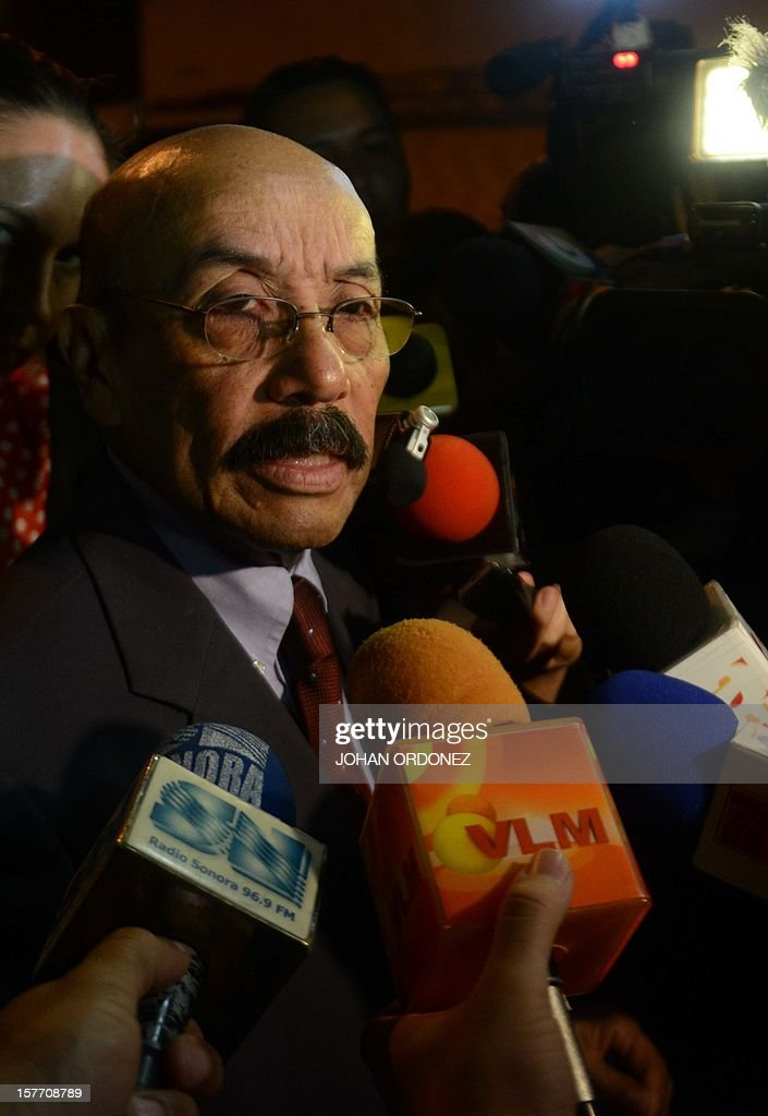 Guatemalan lawyer Telesforo Guerra, who represents US anti-virus software pioneer John McAfee, speaks with journalists outside the detention center of the immigration departament in Guatemala City on December 05, 2012,after he was arrested in the Guatemalan capital for illegal entry, according to police. McAfee requested political asylum in Guatemala, his lawyer said December 5, 2012, after fleeing Belize where he is wanted for questioning over his neighbor's murder.AFP PHOTO / Johan ORDONEZ