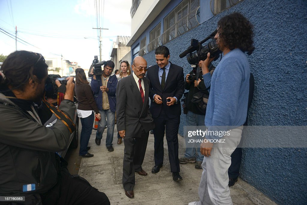 Guatemalan lawyer Telesforo Guerra (L), who represents US anti-virus software pioneer John McAfee, arrives at the detention center of the immigration departament in Guatemala City on December 6, 2012, after McAfee was arrested in the Guatemalan capital for illegal entry, according to police. McAfee requested political asylum in Guatemala, his lawyer said on the eve, after fleeing Belize, where he is wanted for questioning over his neighbor's murder.AFP PHOTO / Johan ORDONEZ