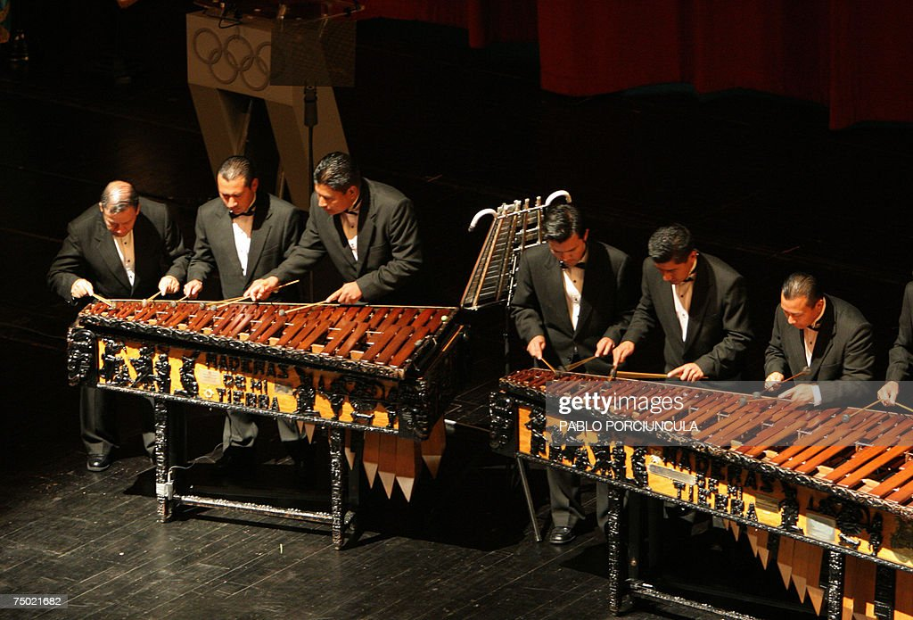 Guatemalan musicians play the marimba, a typical Guatemalan musical instrument, 03 July 2007 in Guatemala City during opening ceremonies for the 119th International Olympic Committee, slated to decide which of the three cities -- Sochi in Russia, Pyeongchang in South Korea, and Salzburg in Austria -- will host the 2014 Winter Olympic Games. AFP PHOTO/Pablo PORCIUNCULA