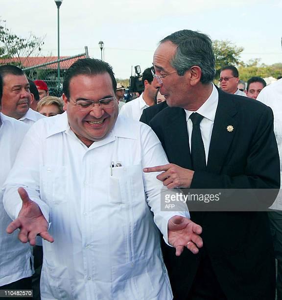 Guatemalan President Alvaro Colom jokes with Governor of Veracruz State Javier Duarte during a visit at the Cumbre Tajin indigenous festival in...