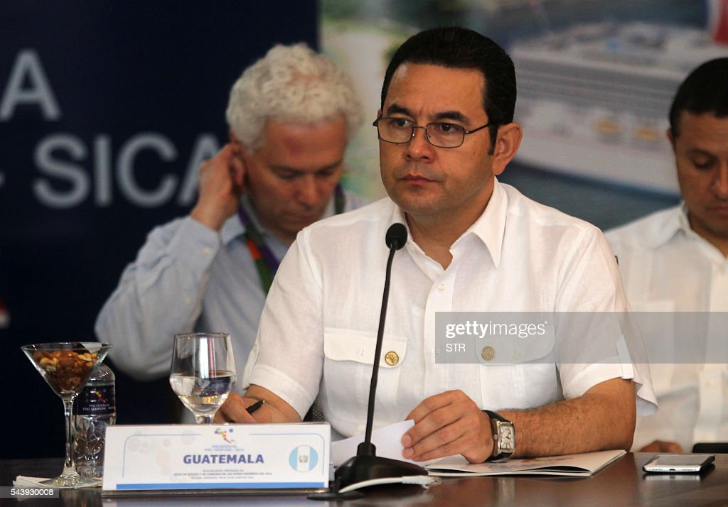 Guatemalan President Jimmy Morales attends the XLVII Ordinary Meeting of the chiefs of state members of the Central American Integration System (SICA) in Roatan island, Honduras, on June 30, 2016. Belize, Costa Rica, El Salvador, Guatemala, Honduras, Nicaragua, Panama and Dominican Republic are members of the SICA. / AFP / STR