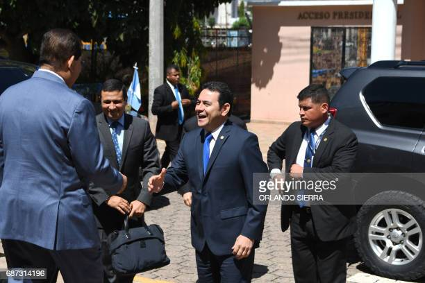 Guatemalan President Jimmy Morales greets Honduran government employees upon his arrival at the presidential house in Guatemala City on May 23 2017...