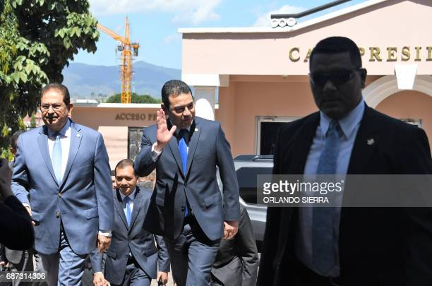 Guatemalan President Jimmy Morales waves as he arrives at the presidential house in Guatemala City on May 23 to meet with his Honduran counterpart...