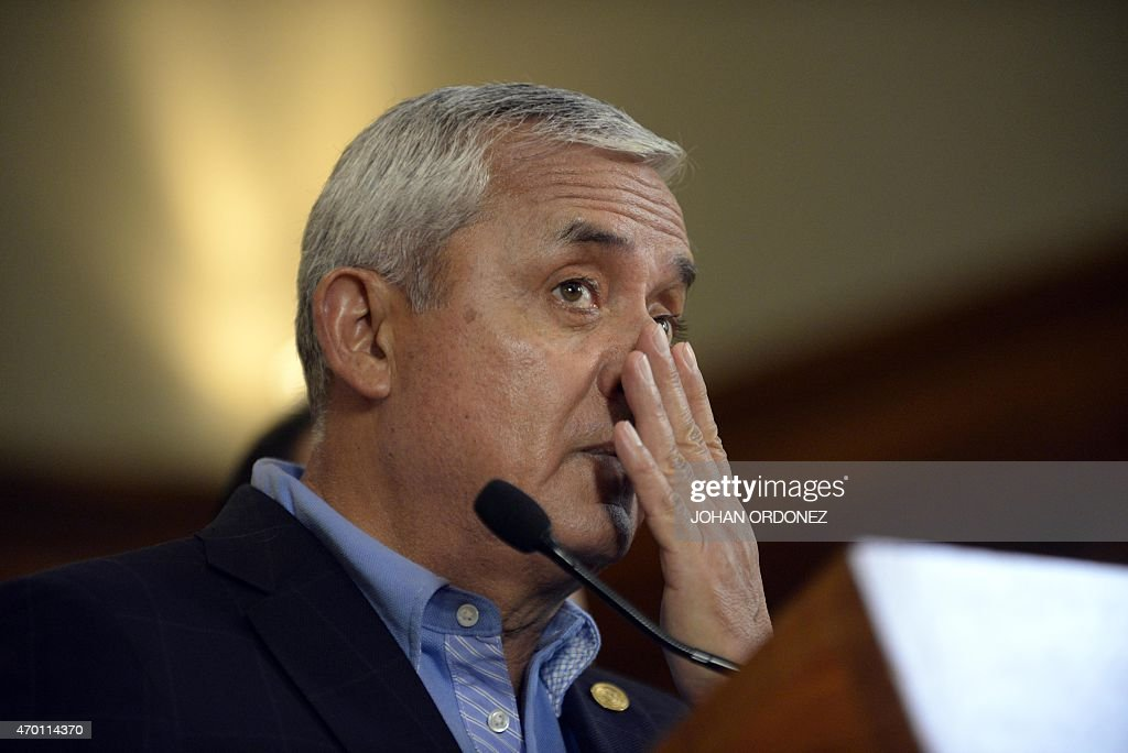 Guatemalan President Otto Perez Molina gestures during a press conference at the presidential residence in Guatemala City on April 17, 2015. Perez Moline informed about the operation carried out by security authorities and members of the International Commission against Impunity in Guatemala (CICIG), that eventually led to the arrest of about 20 people on charges of operating a network of smuggling and tax fraud. AFP PHOTO Johan ORDONEZ