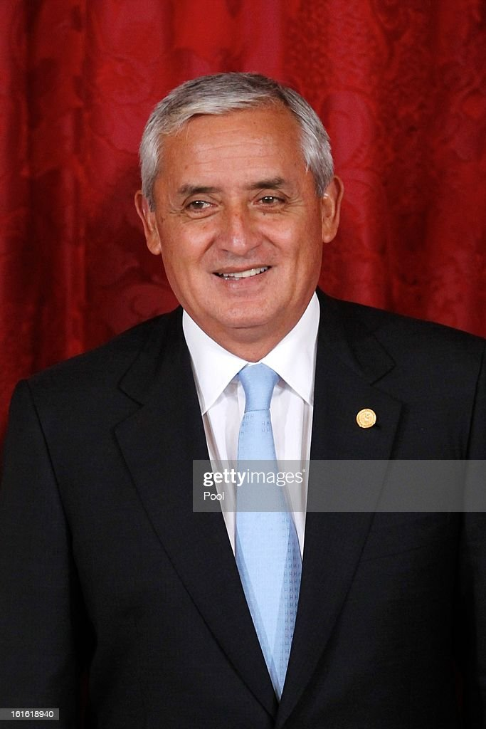 Guatemalan President Otto Perez Molina looks on during his meeting with the Spanish Royal Family at the Royal Palace on February 13 2013 in Madrid...