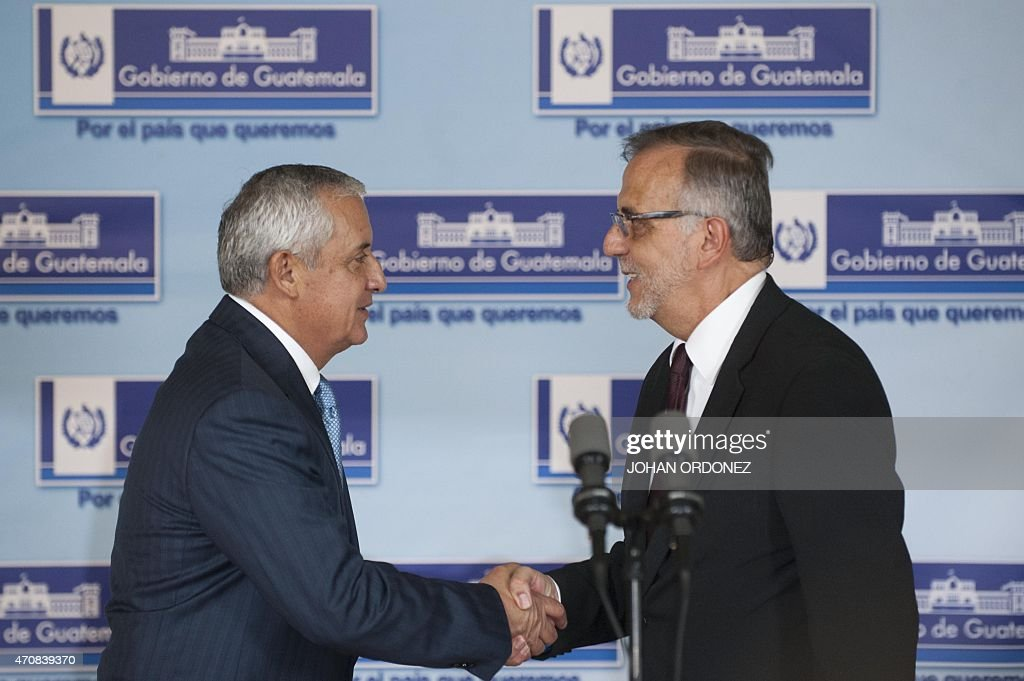 Guatemalan President Otto Perez Molina shakes hands with Colombian Ivan Velasquez chief of the International Commission against Impunity in Guatemala...