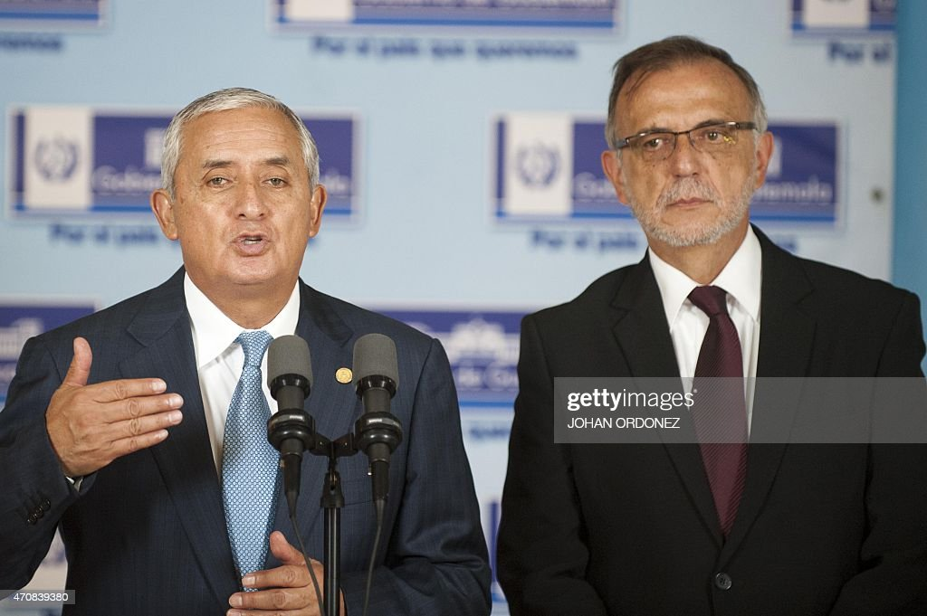 Guatemalan President Otto Perez Molina speaks next to Colombian Ivan Velasquez chief of the International Commission against Impunity in Guatemala...