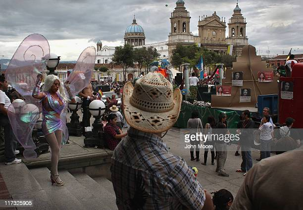 Guatemalans gather to watch and participate in a Gay Pride celebration on June 25 2011 in Guatemala City Guatemala Hundreds of transgender gay and...