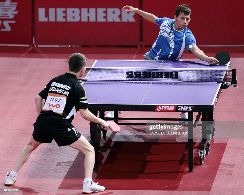 Guatemala's Kevin Soto (Top) returns to Kazakhstan Samat Beisenov during a Men's Singles qualifications groups Table Tennis match at the World Table Tennis Championships on May 13, 2013 in Paris.
