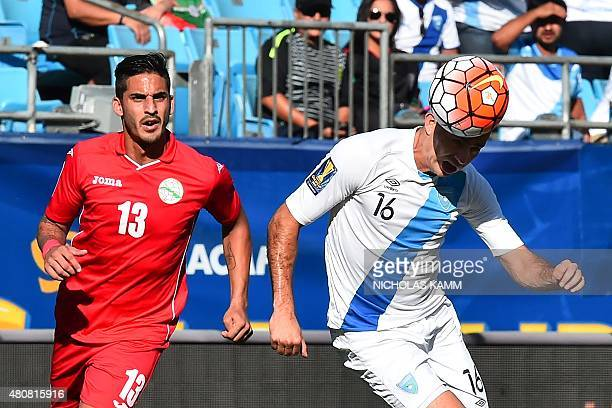 Guatemala's Marco Pappa heads the ball in front of Cuba's Jorge Luis Corrales during a CONCACAF Gold Cup Group C match in Charlotte North Carolina on...