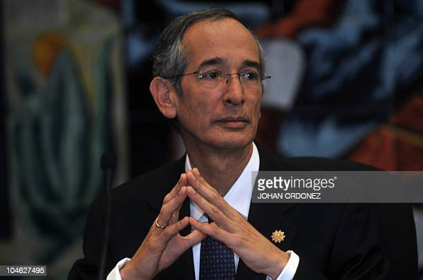 Guatemala's President Alvaro Colom offers a press conference in Guatemala City on October 1 2010 were he described as 'crimes of lesehumanity' the...