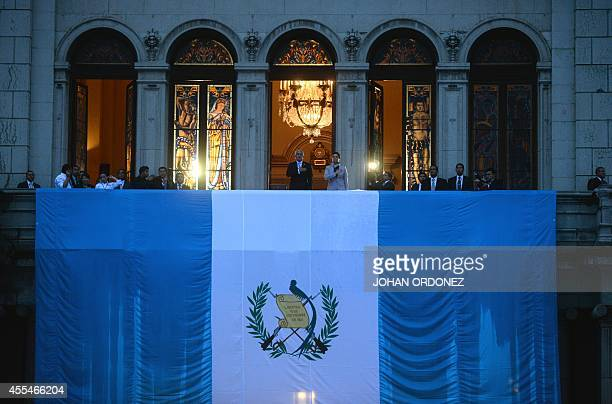 Guatemala's President Otto Perez Molina and VicePresident Roxana Baldetti sing the national anthem during a ceremony at the Palace of Culture as part...