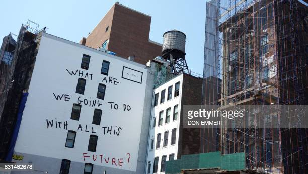 A Gucci ad is displayed on the wall of a Manhattan building August 3 in New York Colossal Media specializes in hand painted ads in New York and...