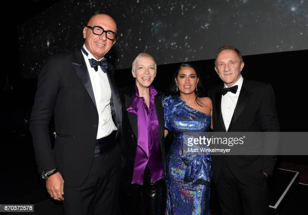 Gucci CEO Marco Bizzarri musician Annie Lennox wearing Gucci actor Salma Hayek wearing Gucci and Chairman and Chief Executive Officer of Kering...