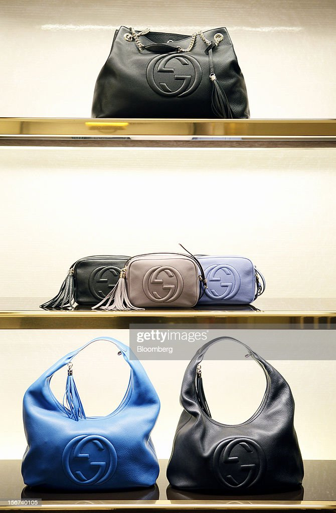 Gucci 'Soho' ladies handbags bearing the interlocking 'G' logo sit displayed for sale inside a Gucci store, a luxury unit of France's PPR SA, in Rome, Italy, on Monday, Nov. 19, 2012. PPR SA, the French owner of the Gucci and Puma brands, said it's confident of revenue and profit growth in 2012. Photographer: Alessia Pierdomenico/Bloomberg via Getty Images