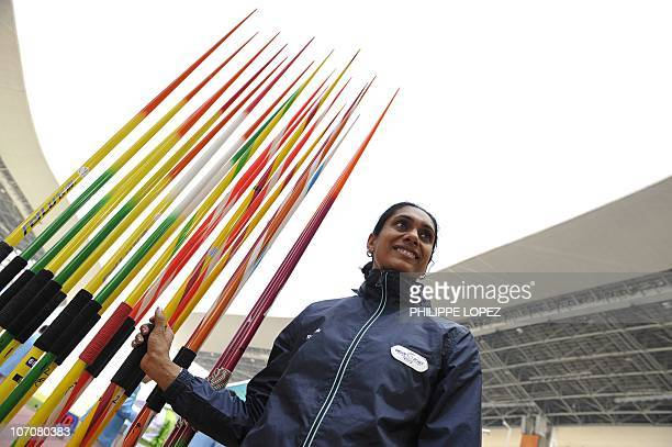 P Gudandda of India stands by the javelins during the women's heptathlon javelin throw event in the athletics competition at the 16th Asian Games in...
