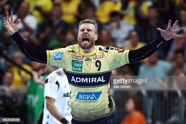 Gudjon Valur Sigurdsson of RheinNeckar Loewen celebrates a goal during the EHF Champions League Quarter Final Leg 2 match between Rhein Neckar Loewen...