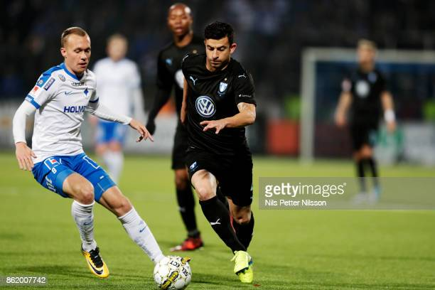 Gudmundur Thórarinsson of IFK Norrkoping and Behrang Safari of Malmo FF competes for the ball during the Allsvenskan match between IFK Norrkoping and...