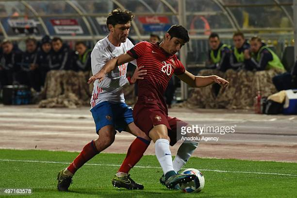 Guedes of Portugal and Zhirkov of Russia contest the ball during the friendly match between Russia and Portugal at Kuban Stadium in Krasnodar Russia...
