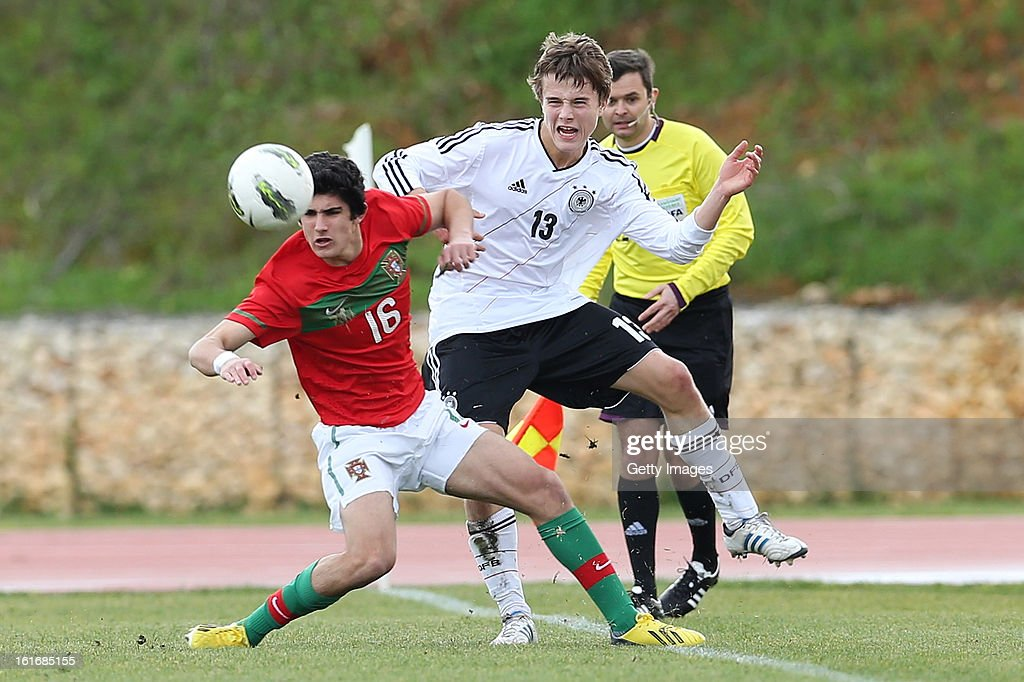 Guedes (L) of Portugal challenges Niklas Teichgraber of Germany during the Under17 Algarve Youth Cup match between U17 Portugal and U17 Germany at the Stadium Bela Vista on February 12, 2013 in Parchal, Portugal.