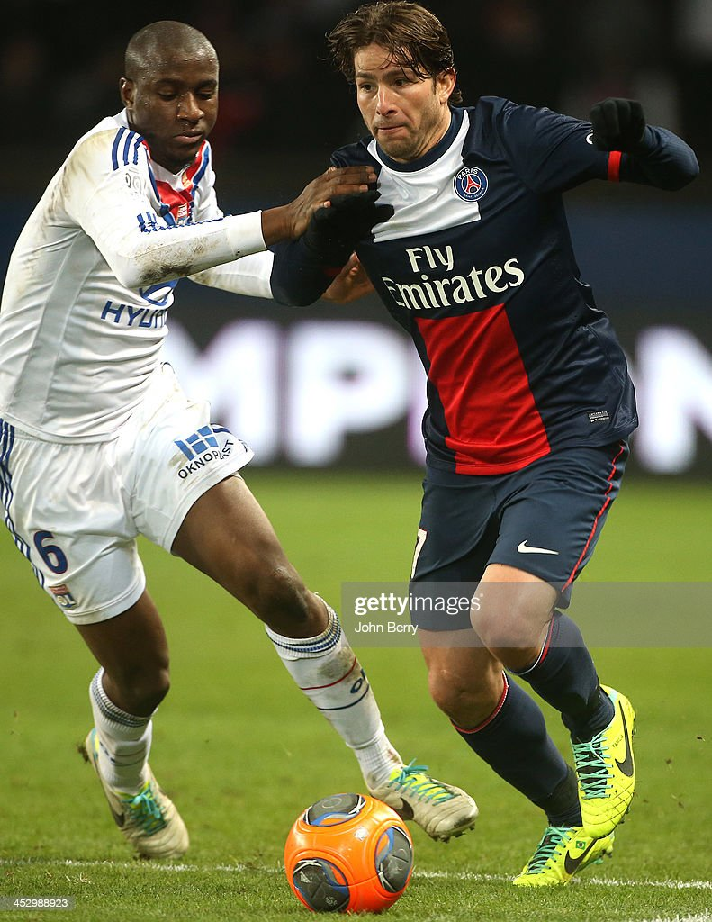 Gueida Fofana of Lyon and Maxwell Scherrer of PSG in action during the French Ligue 1 match between Paris Saint-Germain FC and Olympique Lyonnais at the Parc des Princes stadium on December 1, 2013 in Paris, France.