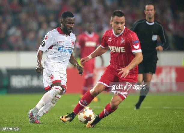 Guelor Kanga of Belgrad and Christian Clemens of Koeln battle for the ball during the UEFA Europa League group H match between 1 FC Koeln and Crvena...