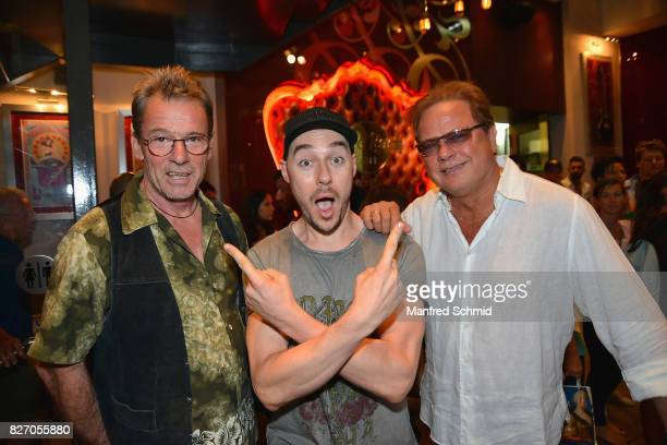 Guenter Grasmuck of Opus painter Tom Lohner and Ewald Pfleger of Opus pose during the 3rd birthday party of the Hard Rock Cafe Vienna on August 6...