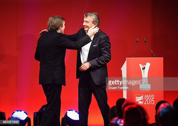 Guenter Netzer recieves his lifetime achievement award from Wolfgang Niersbach DFB president at the Sport Bild Awards 2015 on August 17 2015 in...
