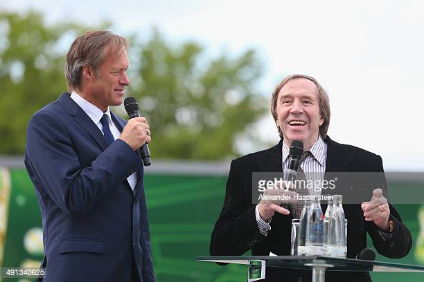 Guenter Netzer talks to the guests during the opening of the DFB Walk of Fame at Olympiastadion Berlin on May 16 2014 in Berlin Germany