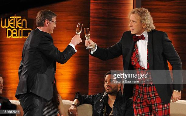 Guenther Jauch and Thomas Gottschalk drink on Jauch's promise to think over succeeding Thomas Gottschalk in his role as host during the 199th 'Wetten...