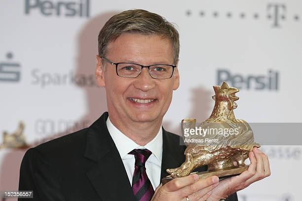 Guenther Jauch holds up his award at 'Goldene Henne' 2012 award on September 19 2012 in Berlin Germany
