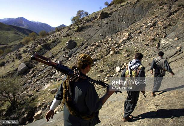 PKK guerillas patrol through a mountain pass along the IraqIran border in the mountains of northern Iraq's Kurdish autonomous region 20 November 2006...