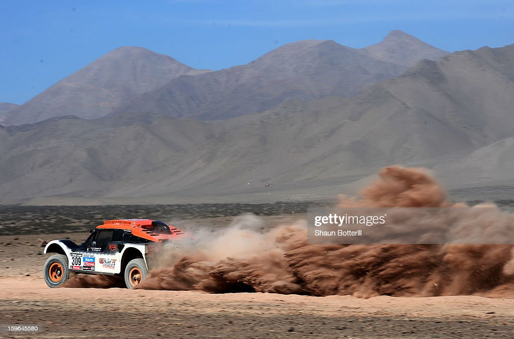 Guerlain Chicherit and co-driver Jean-Pierre Garcin of team Buggy compete in stage 12 from Fiambala to Copiapo during the 2013 Dakar Rally on January 17, 2013 in Fiambala, Argentina.