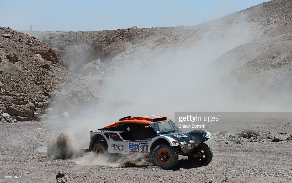 Guerlain Chicherit and co-pilot Jean-Pierre Garcin of team Buggy compete in stage 5 from Arequipa to Arica during the 2013 Dakar Rally on January 9, 2013 in Arequipa, Peru.