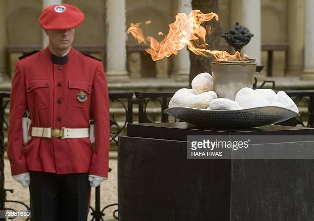 An Ertzaina Basque regional policeman stands next to a memorial flame to commemorate the 70th anniversary of the aerial bombardment of the Basque...