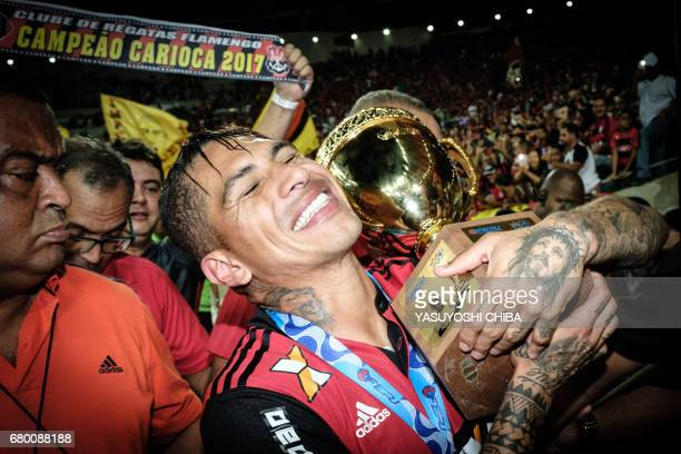 Guerrero of Brazil's Flamengo holds the champions cup after winning against Fluminense the Copa Carioca football match at Maracana stadium in Rio de...