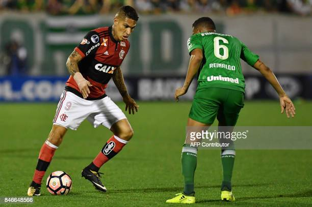 Guerrero of Brazil's Flamengo vies for the ball with Reinaldo of Brazils Chapecoense during their 2017 Copa Sudamericana football match held at Arena...