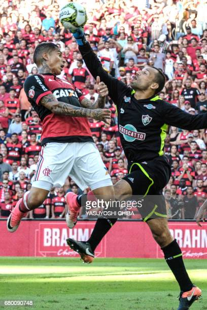 Guerrero of Brazil's Flamengo vies the ball with goalkeeper Diego Cavalieri of Fluminense during their the Copa Carioca final football match at...