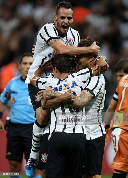 Guerrero of Corinthians celebrates scoring the second goal with Renato Augusto and Jadson during a match between Corinthians and Danubio as part of...