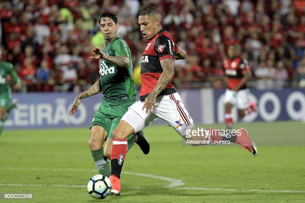 Guerrero of Flamengo battles for the ball with Victor Ramos of Chapecoense during the match between Flamengo and Chapecoense as part of Brasileirao...