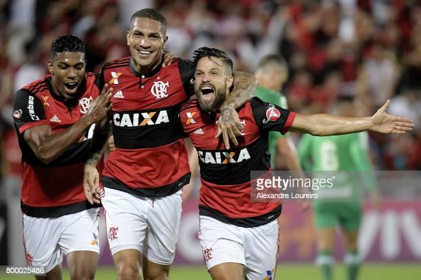 Guerrero of Flamengo celebrates a scored goal with Orlando Berrio and Diego during the match between Flamengo and Chapecoense as part of Brasileirao...