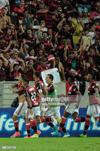 Guerrero of Flamengo celebrates with teammates upon scoring against Fluminense during their Copa Carioca final football match at Maracana stadium in...