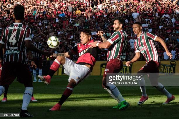 Guerrero of Flamengo vies for the ball with Henrique Dourado of Fluminense during their Copa Carioca final football match at Maracana stadium in Rio...
