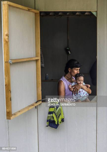 FARC guerrilla Esperanza holds her baby Desire at their camp in the Transitional Standardization Zone in Pondores La Guajira department Colombia on...