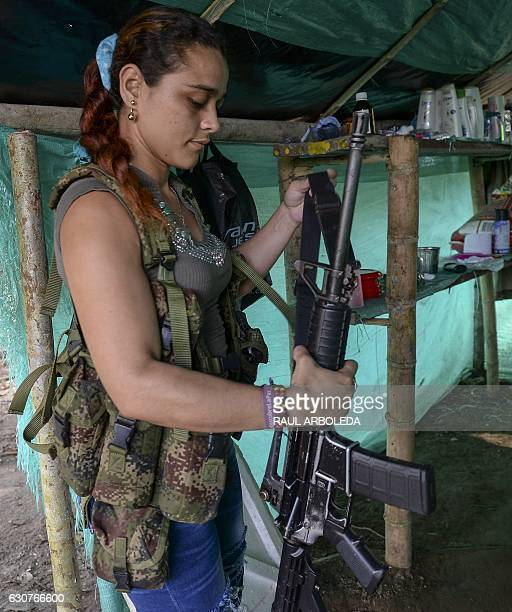 FARC guerrilla fighter Cristina holds her rifle at the Front 34 Alberto Martinez encampment after the New Year's celebration in Vegaez municipality...