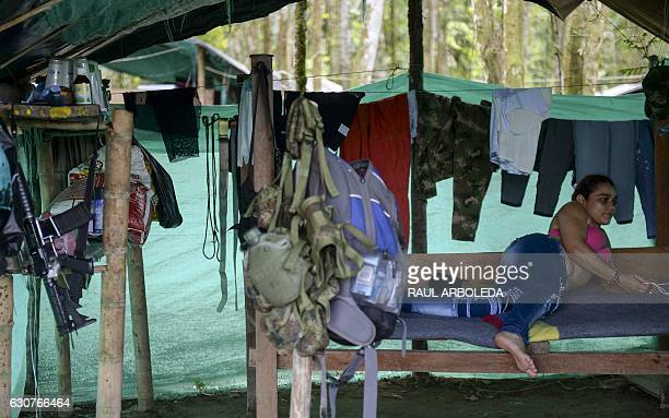 FARC guerrilla fighter Cristina rests at the Front 34 Alberto Martinez encampment after the New Year's celebration in Vegaez municipality Antioquia...