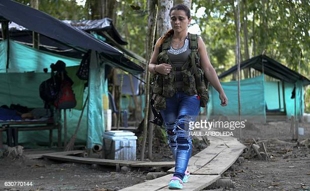 A FARC guerrilla fighter walks in the Front 34 Alberto Martinez encampment after the New Year's celebration in Vegaez municipality Antioquia...