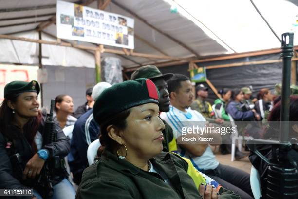 FARC guerrilla fighters attend a daily class inside the assembly tent in a demobilization camp on January 17 2017 in Vereda La Elvira Colombia Jimena...